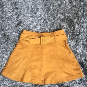 Zara women's mustard colored mini skirt.
